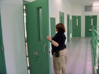 Officer opening cell door
