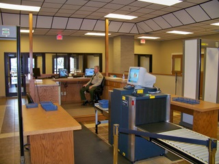 Security screening area with xray machine